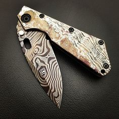 This piece speaks for itself. Mick Strider Custom SMF Cobalt Damascus Nughtmare Grind.