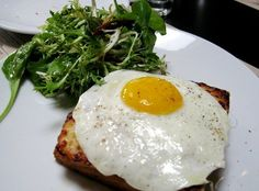 CROQUE MADAME - toasted ham and gruyère sandwich topped with a fried egg from Comme Ca