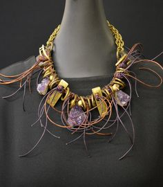 Jewelry as Art! Combining amethyst with antique elements! http://www.flickr.com/photos/gabyblam/