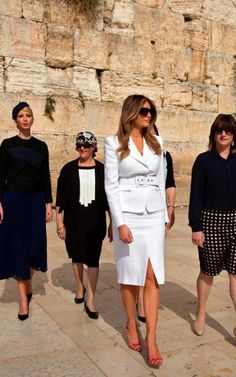 5/22/17 Melania in Jerusalem wearing white suit by Michael Kors paired with red stripe heels (unknown brand). Ivanka is on far lleft in photo. +
