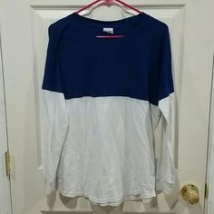 Free with Purchase! VS PINK Long Sleeve In decent used condition. No real rips, tears or stains. The white is a little dingy. Not yellowed but more like the blue kinda mixed and faded the white a bit. Comfy lounging shirt or bed shirt. Free with a purchase just please request when purchasing!  Dog household. Non-smoking household. PINK Victoria's Secret Tops Tees - Long Sleeve