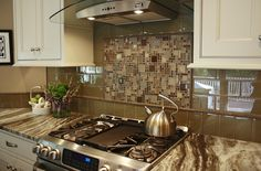 This kitchen features Brown Fantasy Leathered quartzite countertops and a glass tile backsplash. Kitchen by Stoneshop from Cherry Hill, NJ. Kitchen Island With Stove, Kitchen Vent, Shaker Kitchen Cabinets, Stone Kitchen, Kitchen Tops, Kitchen Decor, Cleaning Granite Countertops, How To Install Countertops, Quartzite Countertops