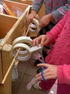 Junk modelling, clever little idea for storing the tape. Would love to make a smaller version for the table. EYFS