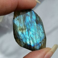 Check out this item in my Etsy shop https://www.etsy.com/listing/212010659/48ct-faceted-labradorite-flash-32x27mm