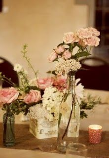 love the idea of different vintage looking centerpieces