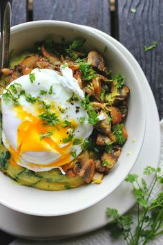 poached egg over spinach polenta with crispy mushrooms + herbs