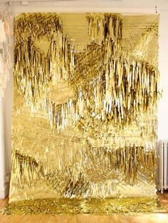 Custom gold fringed wall created for Creature of the Wind's fall/winter presentation 2010, New York.