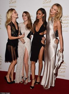Wow: (L-R) Poppy Delevingne, Model of the Year Cara Delevingne, Joan Smalls and Karlie Kloss pose in the winners room