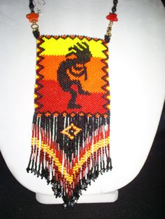 Handmade Kokopelli Pouch Necklace by 5FreeWolves on Etsy