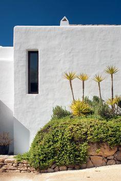 Modern Ibiza home by TG Studio - narrow windows