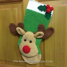 This is a DOWNLOADABLE PATTERN. Written in English using US terminology and Chinese.  This Reindeer Christmas Stocking is the best Christmas decoration and it will brighten up your home during the holidays.  Size: about 13 cm at the top, 32 cm diagonal from loop to toe. Skill level: intermediate © COPYRIGHT *You may not sell or share the pattern. *You may sell the finished items, provided that they are handmade by yourself