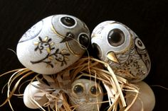 .painted owls on stones