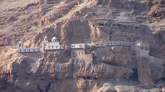 The Monastery of the Temptation (Quruntal) is built along a cliff overlooking the city of Jericho and the Jordan Valley. Upon the summit of the Mount of Temptation.