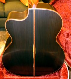 African Blackwood!  Check out the review http://onemanz.com/guitar/reviews/acoustic-guitars/lowden/o50c-african-blackwood/