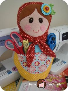 A matryoshka with a pocket to hold sewing equipment, controllers etc. So cute.