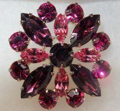 $19.99 starting bid. Eisenberg Ice crystal rhinestone brooch brilliant purples never worn new piece.  Orig retail 49.99