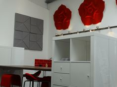 Showing off Soundtect Celeste Acoustic panel in red and the very popular Soundtect Prism in grey both panels acoustically compliment any application