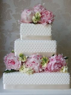 white hobnail wedding cake with peonies