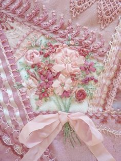 embroidery. ribbon. roses. flowers. pink. pretty. intricate. feminine.