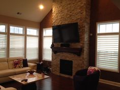 Beautiful natural stone veneer surrounding gas fireplace. Brick by brick pavers and landscaping.