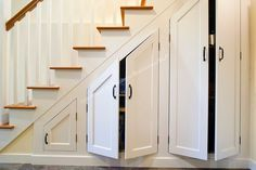 under stair cabinet built ins | Custom cabinets built under the stairs maximize storage in this newly ...