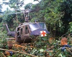 """There was no more welcomed sound of to a wounded soilder in Vietnam than the whop-whop-whop of the """"dustoff Huey"""" coming to get them out of hell. Anyone that has ever flown in a Dustoff Huey wil Vietnam History, Vietnam War Photos, North Vietnam, Vietnam Veterans, Military Helicopter, Military Aircraft, My War, War Image, American War"""
