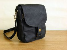 Minus hipster plus in black waxed canvas  hipster hip bag by minus, $60.00