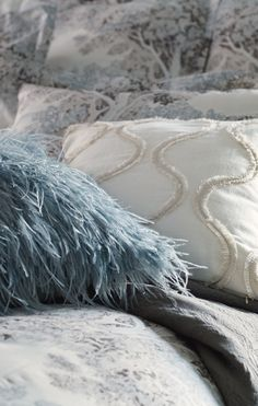 Dancing layers of downy ostrich feathers create whimsical dimension on the face of our Ice Blue Ostrich Feather Decorative Pillow.