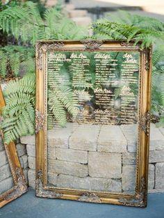 elegant framed glass wedding seating chart