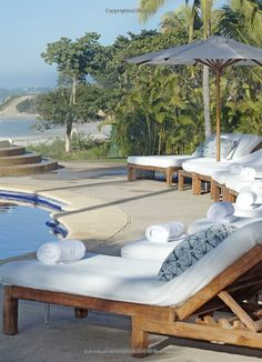 Poolside chaises for relaxing in the sun.