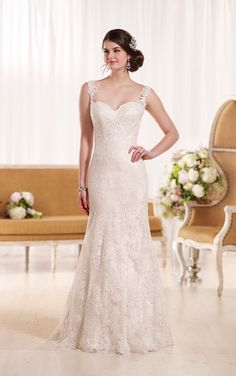 This romantic lace over lustre satin sheath bridal gown features crystal beading and pretty lace shoulder straps. Check out the Essense of Australia collection today! #wedding