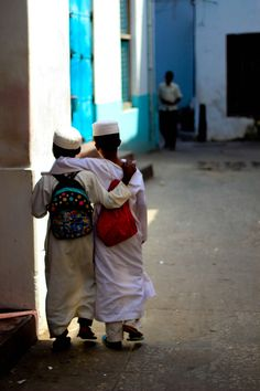 friends walking through stone town in zanzibar, tanzania