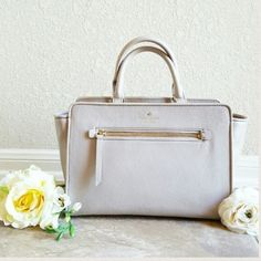 """Kate Spade North Court Corraline Handbag Please see description above for details. New without tags. Only carried once and it was too small for my needs. Only negotiate through offer function. Thanks for looking! Purse for sale is the grey """"Clocktower"""" shade. Model is just showing size and wearability. kate spade Bags"""