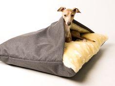 Theo in his Charley Chau Snuggle Bed in Weave Slate