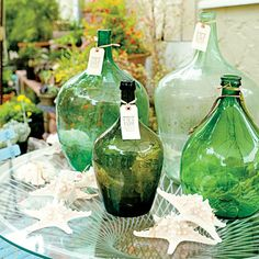 Green bottles (vintage or not?) with raffia tags. From Sunset Magazine, September 2010. pinned from sunset.com