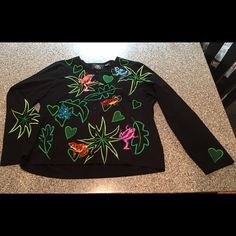 Michael Simon lite L jacket w/ sequin frog design This Large Michael Simon lite jacket is 100% cotton, sequined & embroidered beautifully with lily pad and frog embellishments.  One sleeve features a heart shaped lily pad, and the other, a spiked leaf design.  It buttons up the front, is in excellent condition.  It's not new, was purchased as used, but I never wore it. Michael simon Jackets & Coats
