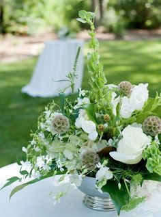 love the natural greens with the pure whites in these wedding flowers!
