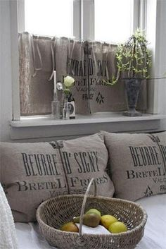 You can get burlap bags like these at Heine Brothers for about $5 each :)