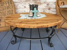 This spool coffee table is the perfect mix of rustic and vintage-industrial. Plus, it will last for generations. Visit Reinvintage Blessings on Facebook or at their website: www.ReinvintageBlessings.wordpress.com to see even more tables. #cablespool #spooltable #cablereel #woodreel #woodenreel #diy #coffeetable