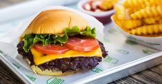 Shake Shack shares the secret recipe for its famous ShackBurger, slathered in ShackSauce and covered in American cheese.