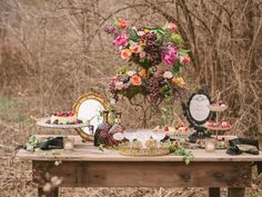 Bring the indoors outside for a summer buffet that drips with style, featuring  peonies , tulips, ranunculus, pink majolica roses, heather, blizzard roses, ivy, privet berries, euphorbia, berzillia berries, and edibles such as pomegranate, plums and pears. Bowls of berries include raspberries, blackberries and strawberries are displayed along with chocolates and chocolate liqueur in this beautiful still life from  Cedarwood Weddings.