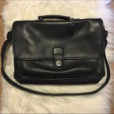 """Coach 5180 Black Briefcase Laptop Bag Beautiful black coach 5180 briefcase, I believe from the 90's. It has VERY MINOR usage/scuffing and is in great condition. It measures: 15.5"""" width, 10.5"""" tall and 3"""" depth. The main flap is just a large open space with no pockets except for a small slit pocket on the coach flap. The front pocket is large and has 3 pen pockets, 1 larger pocket and 1 ID/Business card pocket. Let me know if you have any questions! Coach Bags Laptop Bags"""