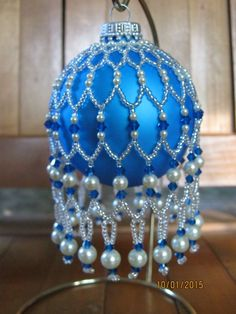 Adoree in capri on blue ball Beaded Christmas Decorations, Crochet Christmas Ornaments, Christmas Jewelry, Holiday Ornaments, Christmas Crafts, Christmas Bulbs, Blue Christmas, Beaded Ornament Covers, Beaded Ornaments