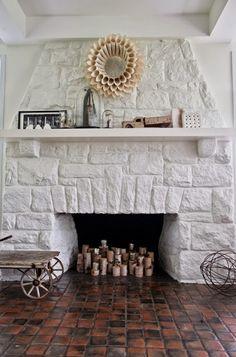 im digging stone fireplaces…via The Decorista