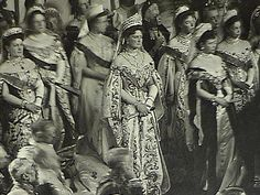 Empress Alexandra Feodorovna (center) in a richly embroidered dress is standing between Grand Duchess Maria Pavlovna (left) and Empress Maria Feodorovna with her two daughters.