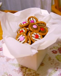 Pretzel Button Candies for gift giving!                                          O shaped pretzels with striped hershey's kisses and m & m's.  how cute!
