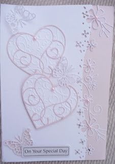Dies used are memory box nottingham border, isabella and pippibutterflies and silverdale heart. White cardstock and pale pink pearlescent ...