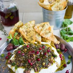 Labneh Dip with Zaatar Pistachio Mint Olive Topping. This the BEST lightest and most flavorful way to do a DIP! Use Greek yogurt for a quick substitute, and pile up the sweet, crunchy, spicy,toasty and salty--ABSOLUTELY delicious! Get the recipe for this dip, Zaatar chips and labneh from scratch! www.twopurplefigs.com
