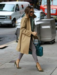 S.J.P. in a trench coat, skinny jeans, top, scarf, Pointy Toes, & satchel with some sunnies. Simple yet chic