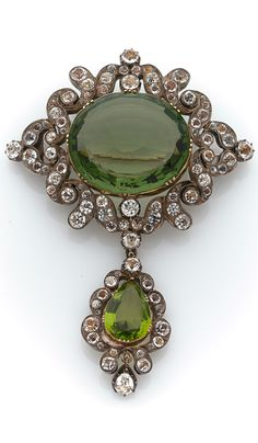 A silver and gold brooch, circa 1840, green and white pastes, mounted in 18k gold, silver, probably English, 32.4g, 8.5 x 6.2cm